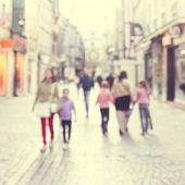 Blurred image of people in the city.