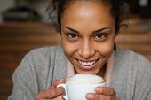 African American Woman Smiling With Cup Of A Coffee