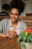 Beautiful Woman Smiling With Glass Of Orange Juice
