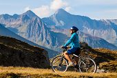 Cyclist Woman In Hight Mountais