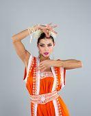 Beautiful Indian girl dancing in national dress
