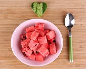 Slices of watermelon in plate on cutting board closeup
