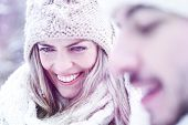 Man and woman smiling in winter together in the snow