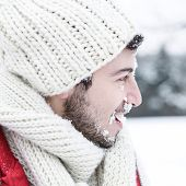 Man in winter with snow in his face at a snowball fight