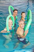 Happy group of people in aqua fitness class in swimming pool