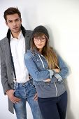 Trendy couple standing on white background