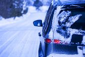 pic of dangerous  - Car covered with snow on a dangerous road with snow and ice - JPG