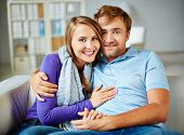 Amorous man and woman in casual having rest at home