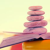 Pebbles Stack On The Book.
