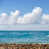 Bright picture of seashore with blue sky and turquoise sea