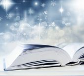 White book in front of abstract holiday background