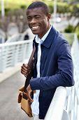 Friendly young trendy african black man walking around the urban city having fun