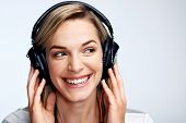 Young girl listening to music on her headphones, dancing, to the music having fun