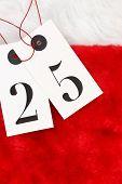 Twenty five on tags on santas fur