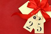 Gift box with and tags with number 25 on red background