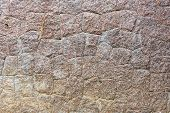 Background texture and pattern of an old weathered stone wall with natural rock cut into irregular shapes