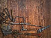vintage jeweler tools  over wooden working bench, space for text