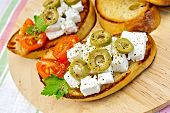 Sandwich with feta and olives on napkin