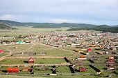 stock photo of primitive  - The sweeping remote hills of Mongolia are marked only by primitive roads and clusters of simple cabins.