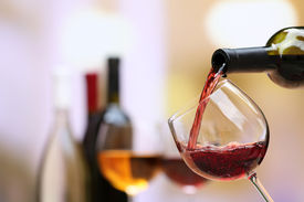 stock photo of liquid  - Red wine pouring into wine glass - JPG