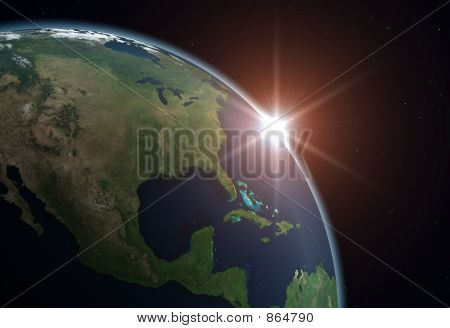 Picture or Photo of Beautiful Planet Earth. Sun rising over North America.
