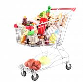 image of grocery cart  - Shopping cart full with various groceries isolated on white  - JPG