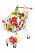 foto of grocery cart  - Shopping cart full with various groceries isolated on white  - JPG