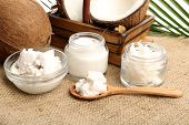 picture of sackcloth  - Coconut with jars of coconut oil and  cosmetic cream on sackcloth on natural background - JPG