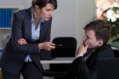 foto of inappropriate  - Boss threatening her male employee horizontal - JPG