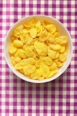 foto of lilas  - Yellow corn flakes in the white bowl - JPG