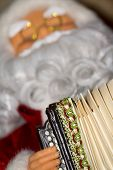 image of accordion  - Christmas santa toy playing the accordion holiday background - JPG