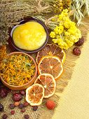 foto of tansy  - Calendula flower oats immortelle flower tansy herb honey wild rose dried lemon on sacking background - JPG