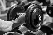 picture of dumbbell  - Man makes exercises dumbbells - JPG