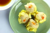 picture of siomai  - Shumai Chinese Steamed Pork Dumplings With Sauce On White Background - JPG