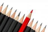 picture of pencils  - One red pencil standing out from the row of black pencils - JPG