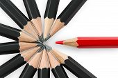 stock photo of rebel  - One red pencil standing out from the circle of black pencils - JPG