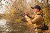 pic of fisherman  - Fisherman on the river bank - JPG
