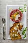 image of tartar  - Beef tartar and toast bread with garlic sprinkled with parmesan shavings and microgreens - JPG