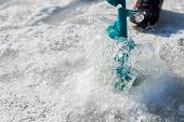 stock photo of ice fishing  - Close-up drill for ice fishing. Winter fishing on the river. Sport, Fishing, river, drill ice fishing. ** Note: Soft Focus at 100%, best at smaller sizes - JPG
