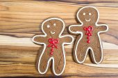 stock photo of gingerbread man  - holiday classic a gingerbread man cookies on a wooden table - JPG