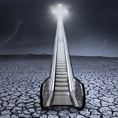 foto of escalator  - An escalator to the cross on dry land with cloudscape - JPG