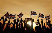 picture of waving  - Group of People Waving Icelandic Flags in Back Lit - JPG
