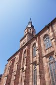 picture of holy-spirit  - Wall and spire of Cathedral of Holy Spirit in Heidelberg at sunny weather - JPG