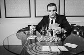 Постер, плакат: Poker player in the casino