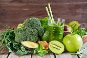 stock photo of fruit shake  - Green detox smoothie with raw vegetables and fruits - JPG