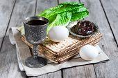 foto of passover  - Wine egg bitter salad leaves matzot and haroset  - JPG