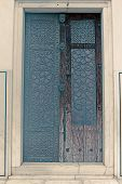 picture of emperor  - Brass craftsmanship on a door at the Bibi - JPG