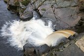 image of chute  - Overflow chute with runningh water from a small dam built to catch the water of a moorland stream - JPG