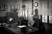 stock photo of trench coat  - Businessman arriving at office holding briefcase and trench coat - JPG