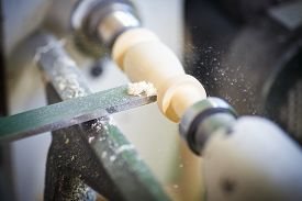 picture of chisel  - hand with a chisel in the course of the woodwork on the machine - JPG